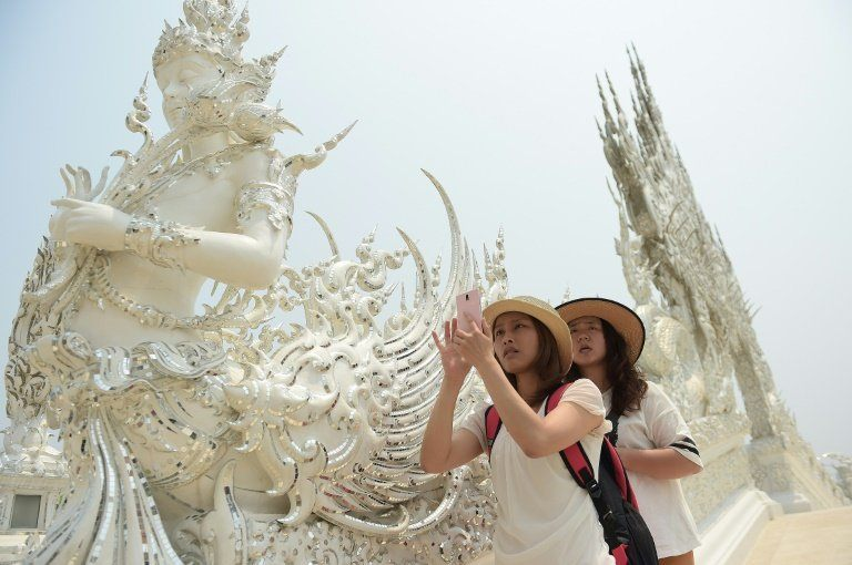 afp-chinese-tourists-boost-thai-economy-but-stir-outrage